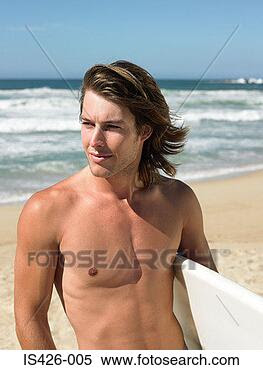 Stock Image - surfer by the  sea. fotosearch  - search stock  photos, pictures,  images, and photo  clipart