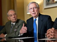 Senate Majority Leader Mitch McConnell, a Republican from Kentucky, center, speaks as Senator Orrin Hatch, a Republican from Utah and chairman of the Senate Finance Committee, right, and Senator Chuck Grassley, a Republican from Iowa, listen during a meeting with members of the committee on tax reform legislation at the U.S. Capitol in Washington, D.C., U.S., on Thursday, Nov. 9, 2017. Senate Republicans released their vision for a tax-cut plan Thursday that would cut the corporate tax rate to 20 percent, with a one-year delay to 2019, as Congress moves quickly to fulfill one of the GOPs biggest and most long-awaited goals. Photographer: Andrew Harrer/Bloomberg via Getty Images