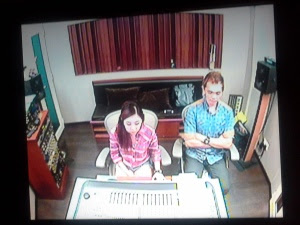 sound engineer Weiqi with Jay at the mixing desk, photo taken from the recording booth
