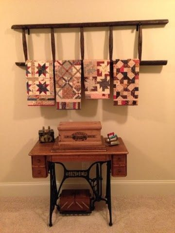 Sewing machine table and quilts on ladder. Put spool cabinet on top of table?