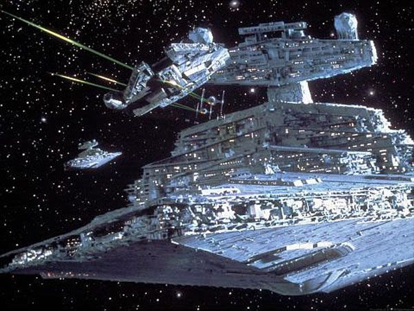 The Millennium Falcon tries to evade TIE Fighters and Star Destroyers in this promo pic from THE EMPIRE STRIKES BACK.