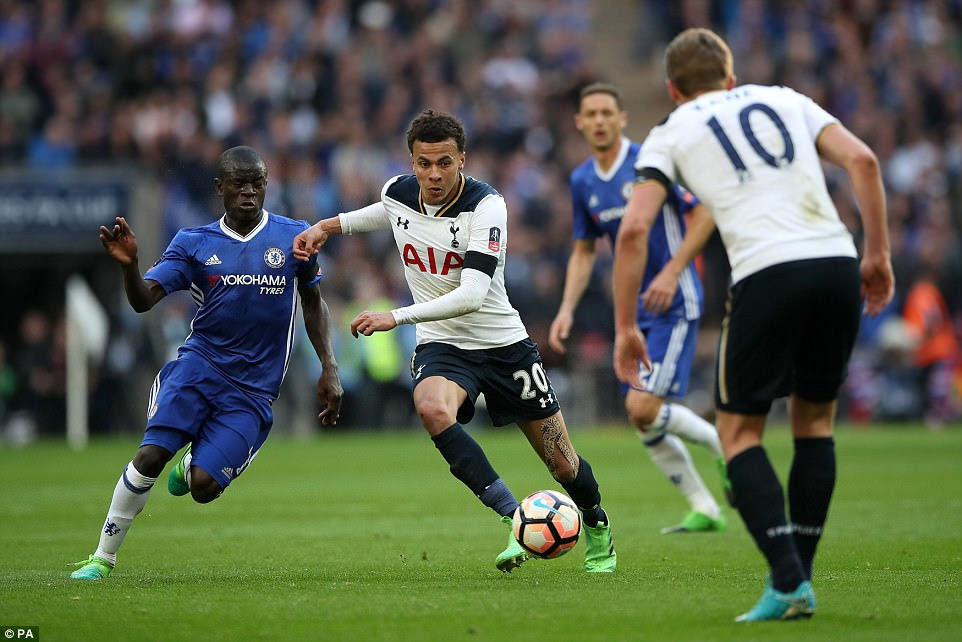 Chelsea midfielder N'Golo Kante chases after Alli as Tottenham look to move forward with the ball