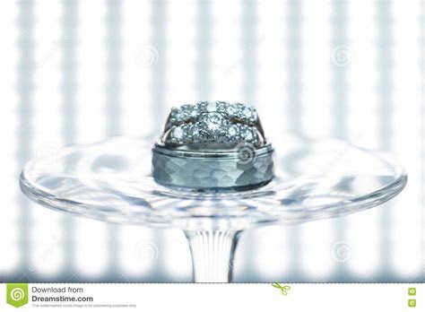 Wedding Rings On A Wine Glass Stock Photography