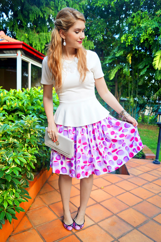 Peplum top and patterned skirt
