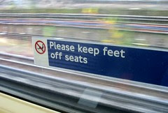 Please keep feet off seats Tube sign