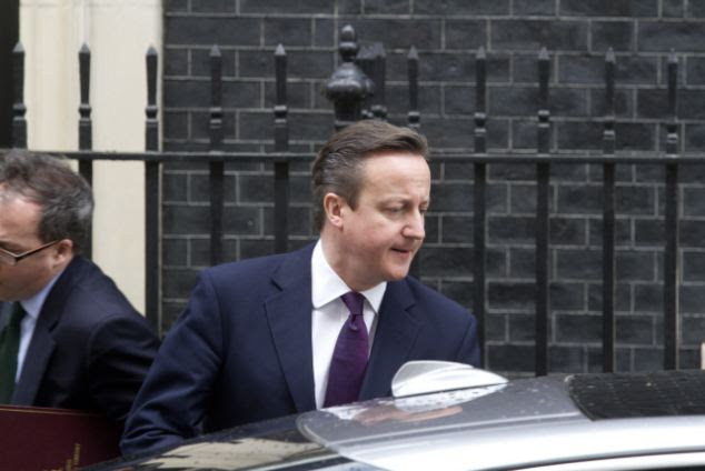 Close aide arrested: Prime Minister David Cameron leaves 10 Downing Street