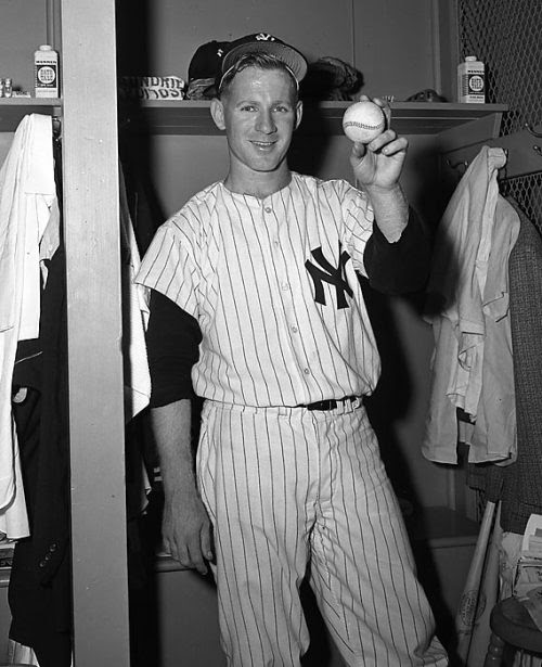 Whitey Ford pictured in the Yankee locker room on the day of his MLB debut.