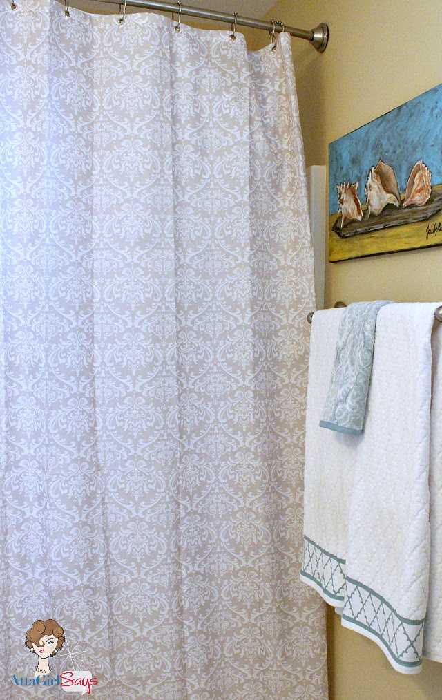 guest bathroom damask shower curtain and shell artwork