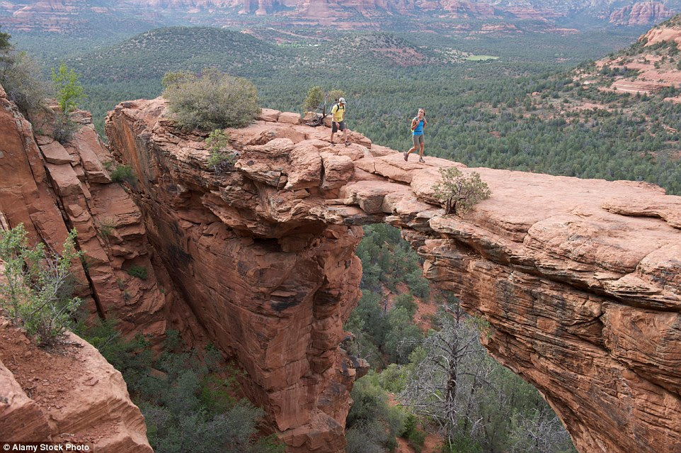 You won't want to stumble while walking across the Devil's Bridge in Red Rock-Secret Mountain Wilderness Area outside Sedona, Arizona, which has sheer drops either side of its arched