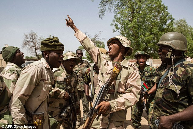 Nigerian troops celebrate after taking control of Bama from Boko Haram militants earlier this week