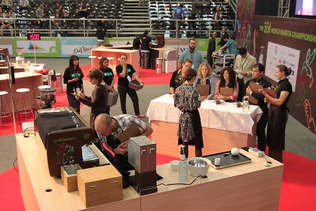 Tech judge checking the machine while AnneStine talks to the sensory judges