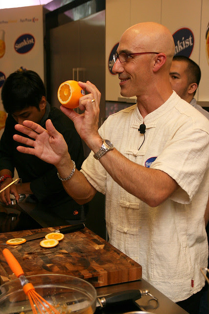 Chef Robert Danhi showing the cut bottom of a navel orange