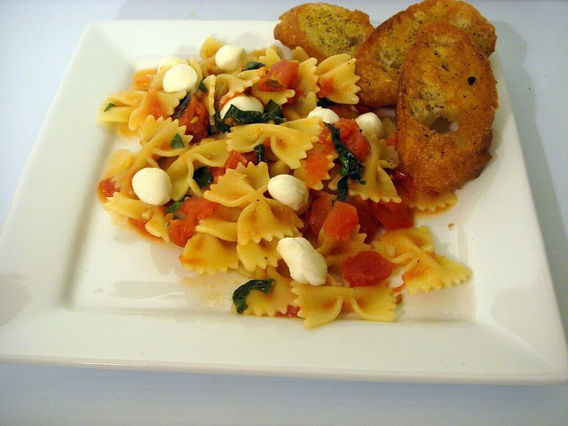 pasta with caprese sauce and pan fried garlic toasts