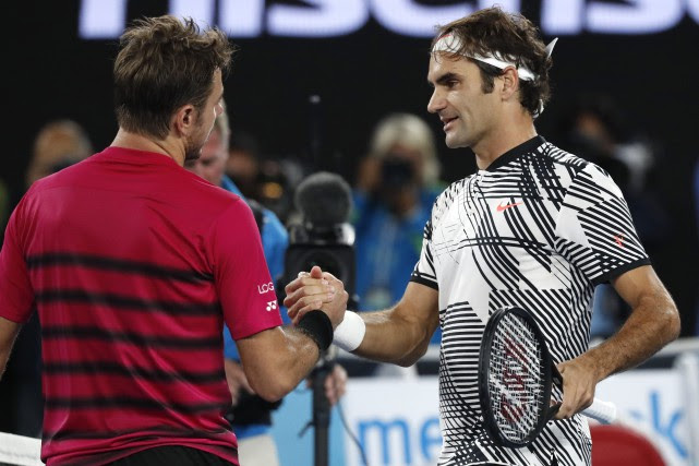 Stanislas Wawrinka et Roger Federer... (Photo Kin Cheung, Associated Press)