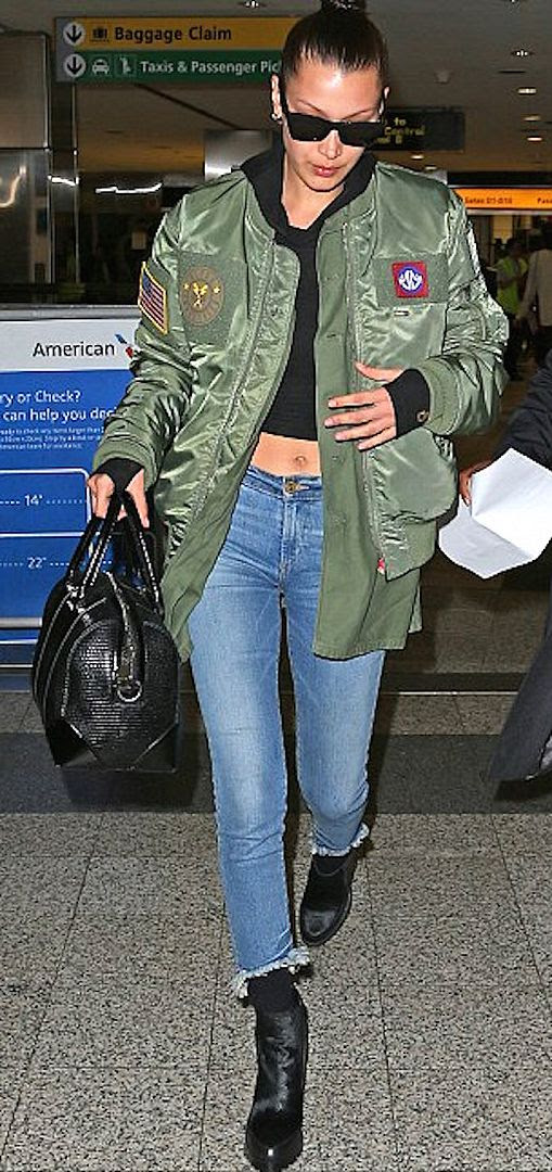 Le Fashion Blog Black Cropped Shirt Raw Hem Jeans Black Heeled Boots Bella Hadid Via Daily Mail