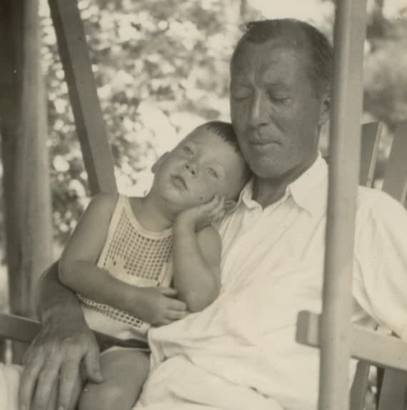 Vintage Sepia Photo of Sleepy Father Dressed in White with His Toddler Son in Lap Summer 1933
