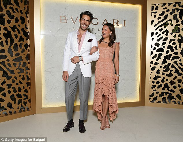 Handsome: Jon Kortajarena looked dapper in grey trousers and a white blazer