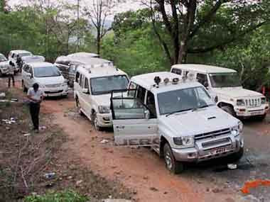 Vehicles at the site of Maoists' ambush on Sunday in Bastar where the Congress party's Parivartan Yatra was attacked on Saturday. PTI