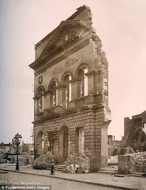 Barely left standing: The front wall of the Hotel de Ville at Bethune in Northern France as seen after heavy shelling during the war