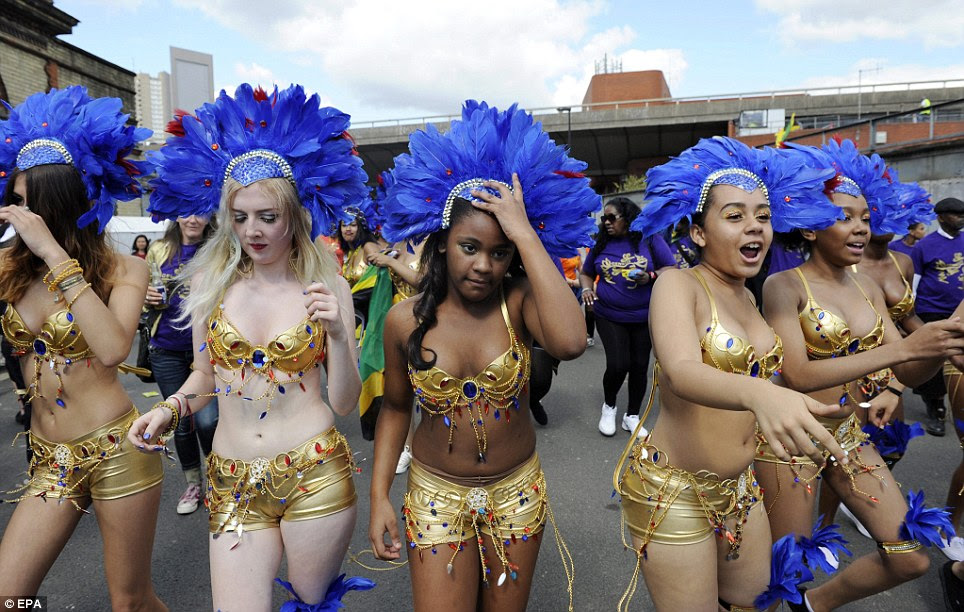 Ready to dance: Those at Notting Hill Carnival today will be praying the weather stays good and the rain stays away