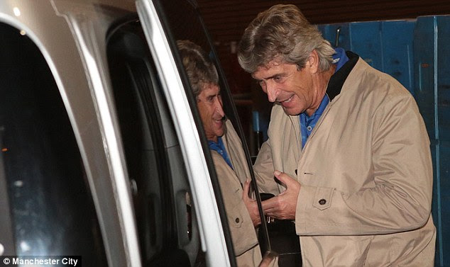 Calling a cab: Pellegrini getting around Manchester using his good English