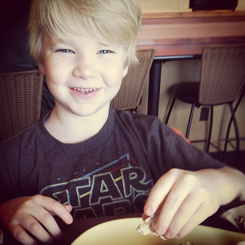 """My breakfast date...I had to cut his bagel up in pieces because he says """"Mom I think I have another wiggly tooth!"""""""