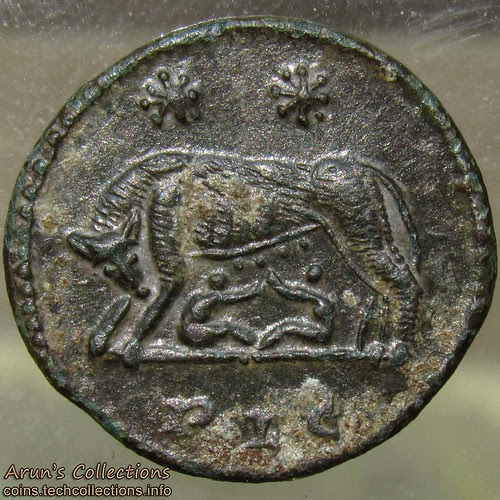 Reverse, wolf nursing twins Romulus and Remus