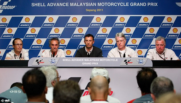 Delivering the news: MotoGp officials relay the tragic announcement
