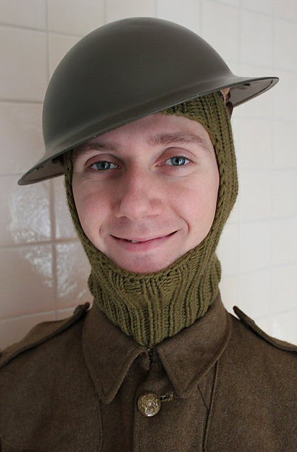 http://www.ravelry.com/projects/misshendrie/balaclava-helmet-with-cape-pieces