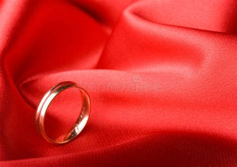 Wedding Ring Over Red Background Stock Photo   Image of