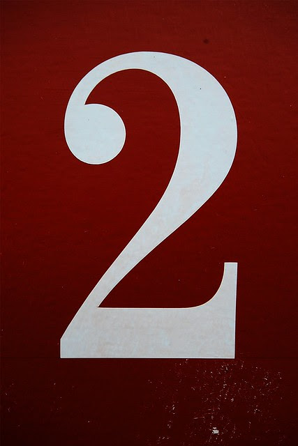 The number 2 on red.