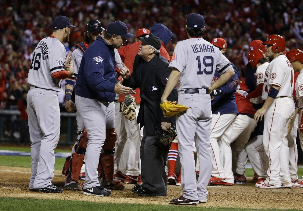 Boston Red Sox manager John Farrell argues with home plate umpire Dana DeMuth after St. Louis Cardinals scored the winning run on an obstruction play during the ninth inning of Game 3 of baseball's World Series Saturday, Oct. 26, 2013, in St. Louis. The Cardinals won 5-4 to take a 2-1 lead in the series