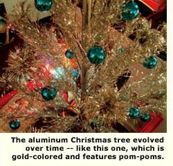 gold xmas tree with pom poms