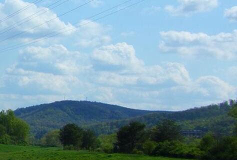 [Photo of hills and sky]