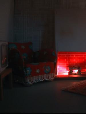 Vintage 1967 Lundby dollshouse lounge with fireplace lit up at night.