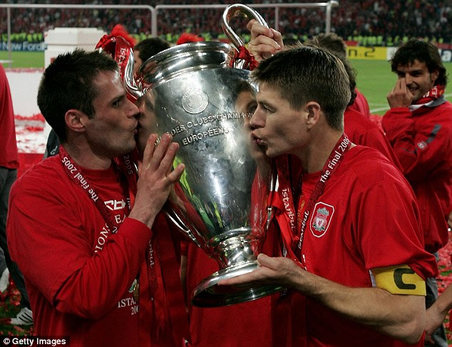Carragher and Gerrard celebrate with the Champions League trophy following the historic victory