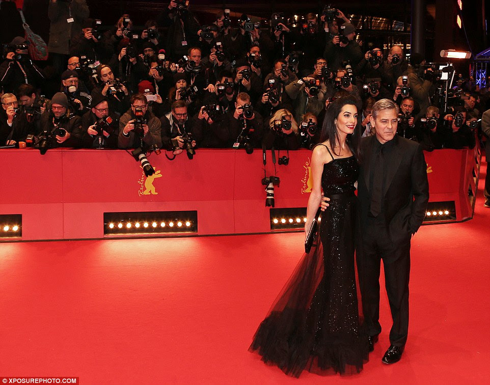 Photogenic power pair: Amal and George were the picture of happily-married bliss as they proudly cosied up together
