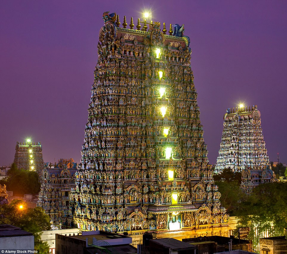 As darkness falls some of the rising gateway towers, or gopurams, are lit up against the night's sky