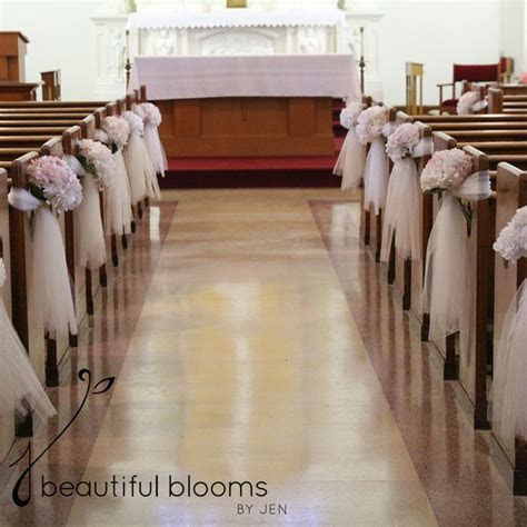Tulle and blush hydrangea pew decorations by Beautiful