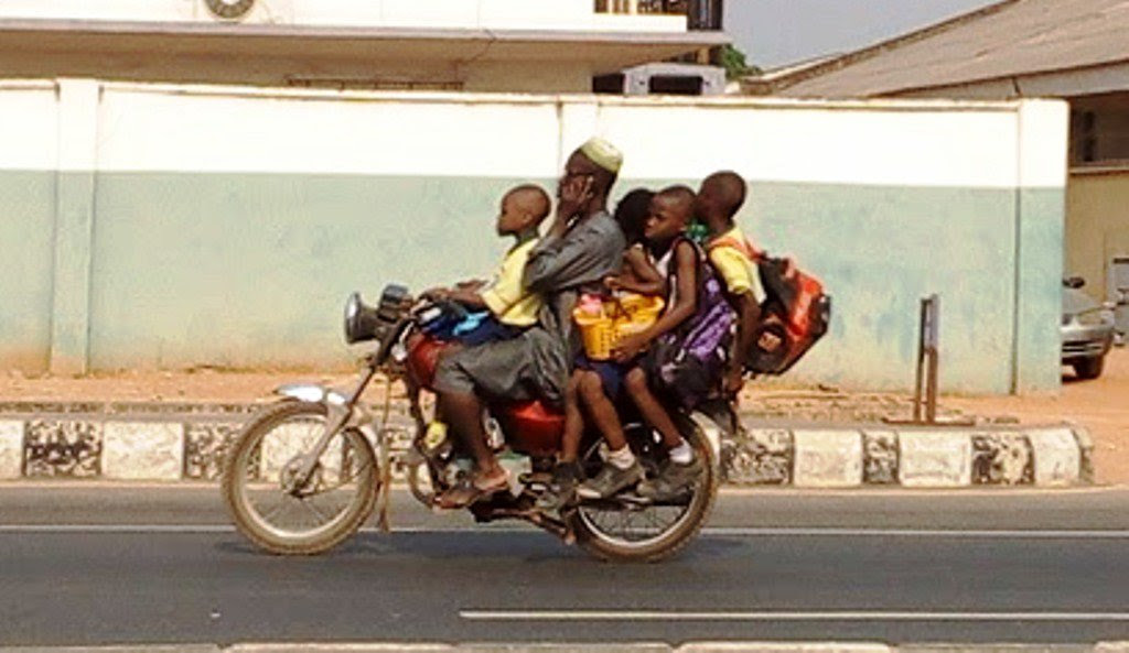 Okada Rider With 4 School Children While On Phone Call (Photos)