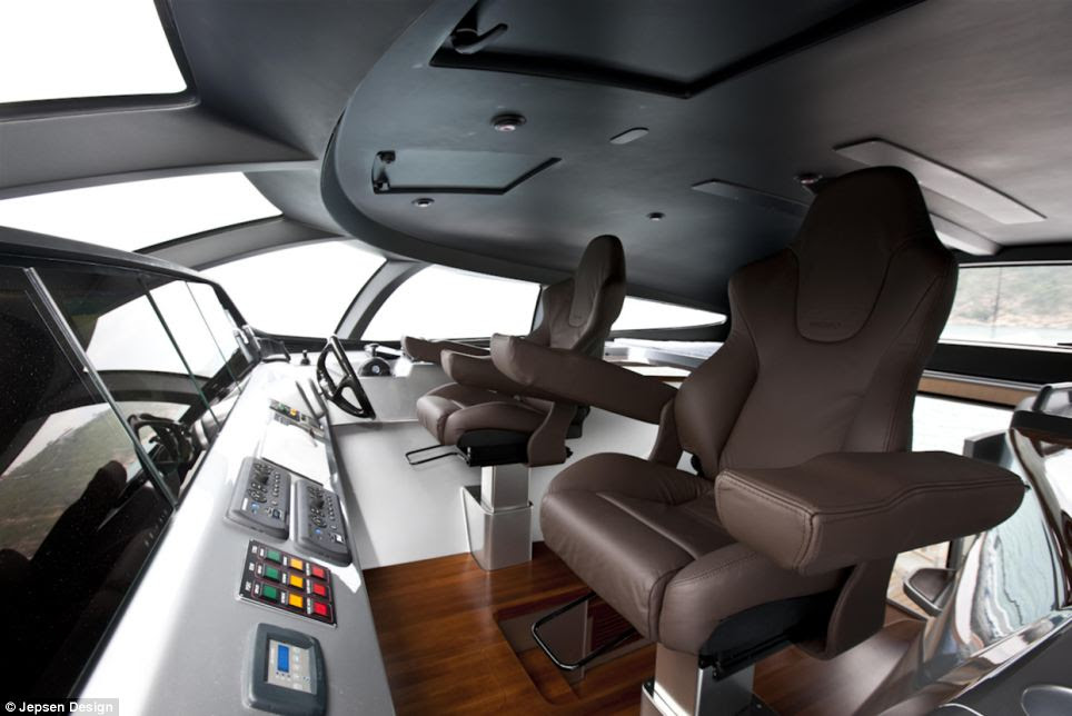 The main helm station, which has seating for two, is positioned in a raised pilot house situated between the rear deck and the saloon area and forms part of the cross beam structure