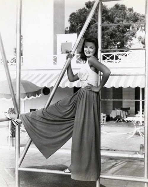 Gene Tierney, shared by Casey of Elegant Musings.  Now I want palazzo pants and a crisp halter top for summer!