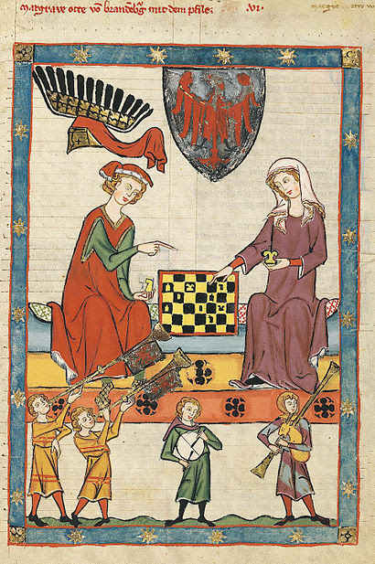 male and female playing chess