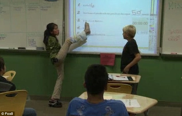 Inspiring: Mary Gannon, a science teacher who was born without arms, teaches students using her feet