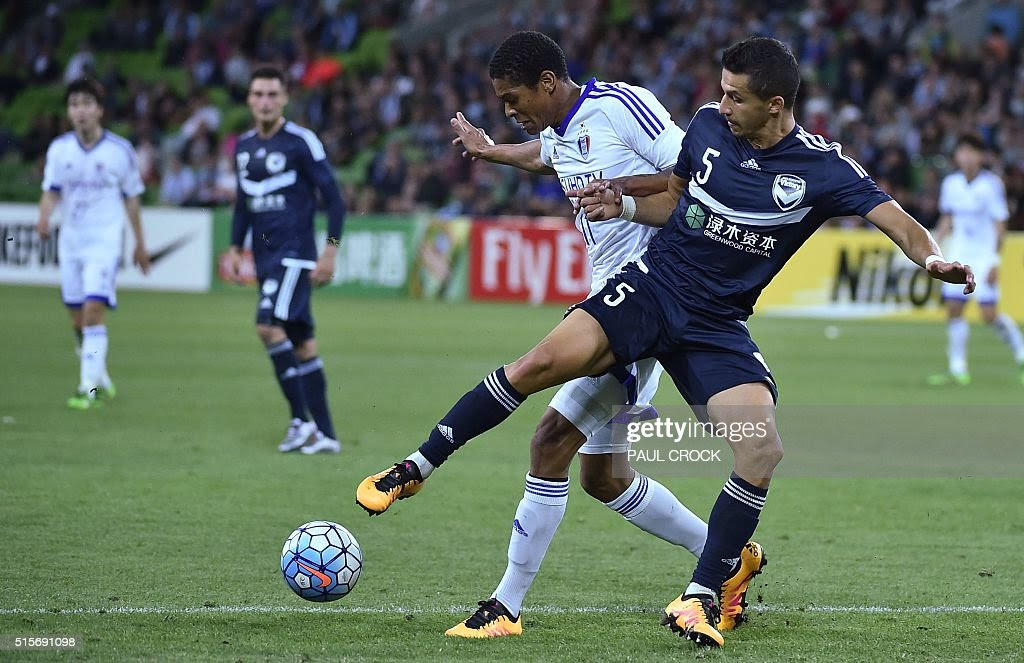 http://media.gettyimages.com/photos/daniel-gerogievski-of-melbourne-victory-fights-for-the-ball-with-picture-id515691098
