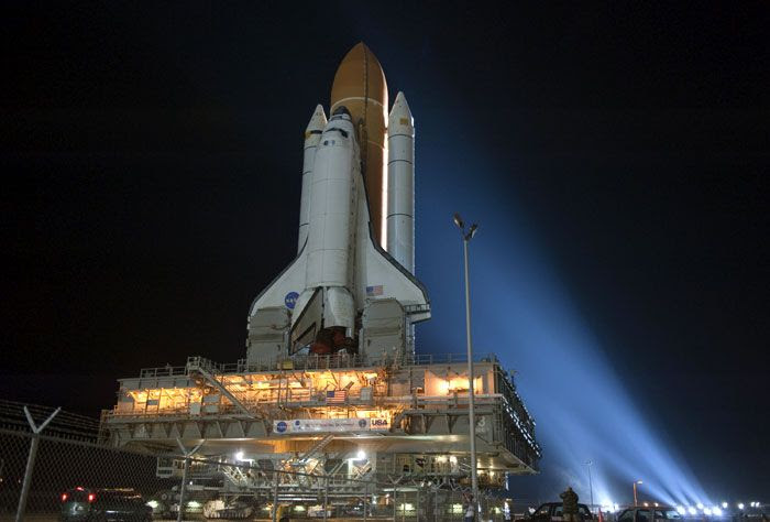 Xenon spotlights focus on space shuttle Discovery as it heads back to Launch Complex 39A (LC-39A) at the Kennedy Space Center in Florida, on January 31, 2011.