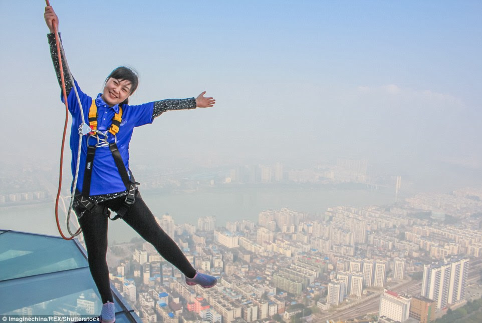 Guests are secured in place by a harness and two ropes, to allow daredevil tourists the chance to pose for some daring shots at the edge