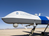 SIERRA VISTA, AZ - OCTOBER 30:  The new MQ-9 Predator B, an unmanned surveillance aircraft system, unveiled by the U.S. Customs and Border Protection (CBP), is seen at Libby Army Airfield at Ft. Huachuca October 30, 2006 in Sierra Vista, Arizona. CBP will use the new MQ-9 Predator aircraft to patrol the southern border of the United Sates in order to stop the illegal entry of thousands of Mexican nationals and drug runners who use the vast expanses of the Sonoran desert to cross into southern Arizona, daily. The new unarmed plane flew briefly for the press to show off its surveillance  capabilities by pilots of the contractor, General Atomics Aeronautical Systems. Agents of CBP will start training on the use of the aircraft very soon. The Predator will start full scale flight operations along the Mexico-Arizona border today.  (Photo by Gary Williams/Getty Images)