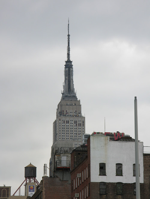 the top of the Empire State Building in overcast weather, Manhattan, NYC