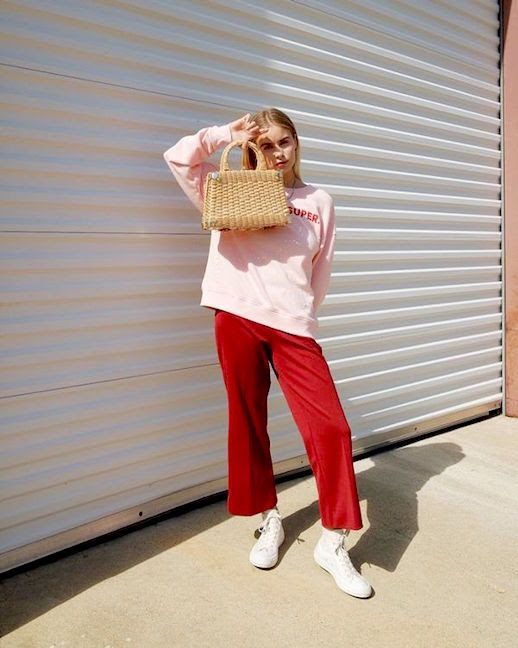 Le Fashion Blog 2 Inspiring Outfits Pink Sweatshirt Red Kick Flare Pants White Sneakers Via @Courtneeruthie